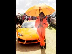 Paul Blake, president of the Port Antonio Taxi Association, poses in front of this posh Lamborghini which is owned by PNP councillor Hugh Graham. Blake was among hundreds of mourners who attended the funeral for slain Member of Parliament for East Portland, Dr Lynvale Bloomfield.