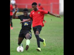 Molynes United's Jermaine Reid (left) makes a challenge on Lime Hall player Shaquill Wallace in their JFF All-Island Confederations Play-offs at the Constant Spring field on Sunday, June 2.