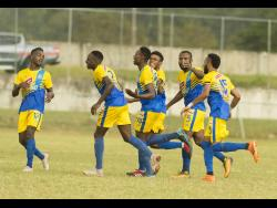 Shemar Nairne (third left) celebrates with Harbour View teammates after scoring against UWI FC in their Red Stripe Premier League match at the UWI Mona Bowl in St Andrew on January 9.