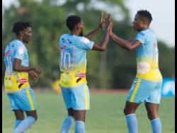 Waterhouse FC's Stephen Williams (right) celebrates his goal scored against Real Hope Football Academy, with teammates Andre Fletcher (left) and Kenroy Howell, in the FLOW Concacaf Caribbean Club Championship match at Stadium East in Kingston, on Tuesday, May 14.