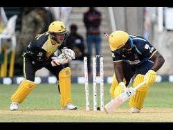 Barbados Tridents batsman Roshon Primus (right) is stumped by Glenn Phillips of the Jamaica Tallawahs during their Caribbean Premier League match at Sabina Park on Sunday, September 15.
