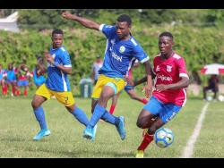 Camperdown's Shaqueil Bradford (right) is hounded by Hydel's Michael Thompson (centre) and Shaquise Batice during their ISSA/Digicel Manning Cup encounter at Alpha Boys Home  yesterday.