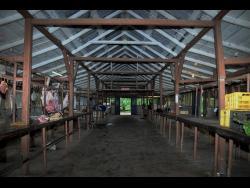 1. Empty stalls are plentiful in Porus Market.
