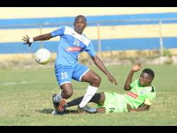 Portmore United's Rondee Smith shakes off a challenge from Molynes United Sergeni Frankson during their Red Stripe Premier League match at the Constant Spring Sports Complex yesterday.Portmore United's Rondee Smith shakes off a challenge from Molynes United Sergeni Frankson during their Red Stripe Premier League match at the Constant Spring Sports Complex yesterday.