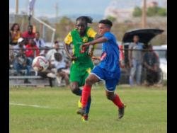 Portmore United's Lamar Walker (right) tussles with Vere United's Devroy Grey for the ball in their Red Stripe Premier League match at the Wembley Centre of Excellence in Hayes, Clarendon, on Sunday, September 8 , 2019.
