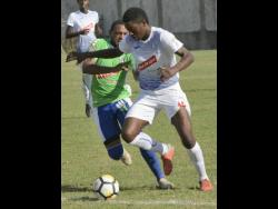 Portmore's Roberto Johnson (right) was sent off during last night's match.
