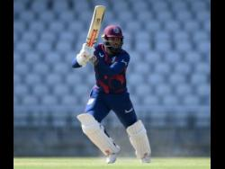John Campbell  bats during Day Two of a West Indies Warm Up match at  Old Trafford on June 24, 2020 in Manchester, England.