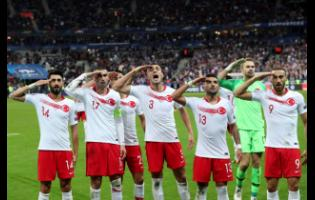 Turkey's players salute as they celebrate a goal against France during their Euro 2020 group H qualifying match at Stade de France at Saint Denis, north of Paris, France, on Monday. Since Turkey announced its incursion into neighbouring Syria to clear out Kurdish fighters last week, patriotic sentiment has run high, with the national team players giving military salutes during international matches among the outward signs of nationalism.