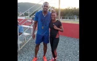 Usain Bolt and Kasonia Smith at the Usain Bolt Track at the UWI Mona Bowl.