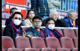 Barcelona fans wear face masks in an attempt to protect themselves from the coronavirus, prior to a Spanish La Liga match against Real Sociedad at the Camp Nou Stadium in Barcelona, Spain, on March 7.