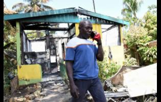 Courtney Marshall contemplates his next move after his house was burnt down by a fire in Linstead, St Catherine, last Saturday.