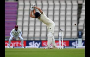 England's Dom Sibley is bowled out on the first day of the 1st cricket Test match between England and West Indies, at the Ageas Bowl in Southampton, England, yesterday.
