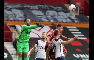 Tottenham's goalkeeper Hugo Lloris (left) makes a save during the English Premier League soccer match between Southampton and Tottenham Hotspur at St Mary's Stadium in Southampton, England, yesterday.