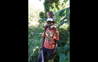 Denzel Lawrence was seen on his farm in Yellant, Gibraltar, St Ann, with his son, Marcodean Lawrence, last Friday.