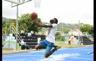 A resident of Buckfield in Ocho Rios,  St Ann, in full flight on the basketball court, which was renovated by the Sandals Foundation.