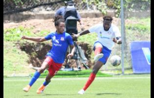 Dunbeholden FC's Kimoni Bailey (left) challenges for the ball against Portmore United's captain, Ricardo Morris, during a Jamaica Premier League match at the Captain Horace Burrell Centre of Excellence, The University of the West Indies (UWI), Mona, on Sunday, June 27.
