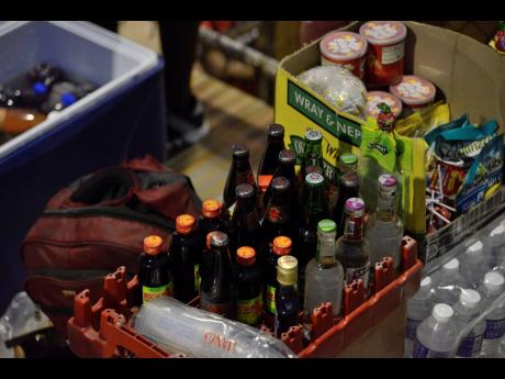 Miscellaneous alcoholic beverages being sold at a ISSA/Digicel Manning Cup football match at the Stadium East field.