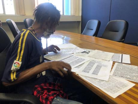 Lynden Minott with the only thing he has of his parents, 60-year-old articles.