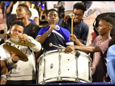 Jamaica College supporters contribute to the atmosphere at the National Stadium with their drums.
