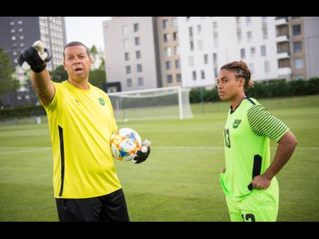 Then national senior women's goalkeeping coach Hubert Busby Jr (left), now named head coach, shares instructions with goalkeeper Nicole McClure during a training session at Stade Eugene Thenard in Grenoble, France, during the FIFA Women's World Cup last summer.